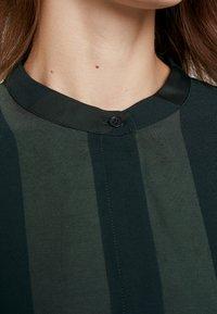 Selected Femme - SLFVIOLA OVERSIZE DRESS - Shirt dress - scarab - 6