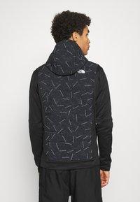 The North Face - TRAIN LOGO HYBRID INSULATED JACKET - Light jacket - black - 2