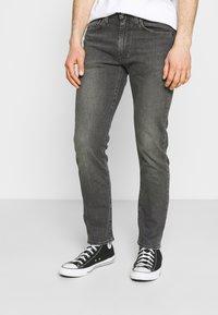 Levi's® - 502 TAPER - Slim fit jeans - blacks - 0