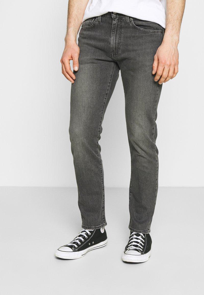 Levi's® - 502 TAPER - Slim fit jeans - blacks