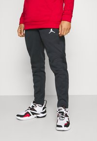 Jordan - AIR THERMA PANT - Pantalones deportivos - black/white - 0