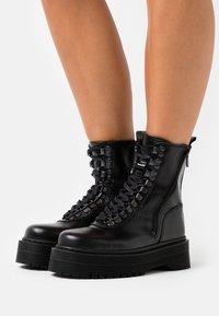 The Kooples - AVEC LOGO AU DOS - Cowboy/biker ankle boot - black - 0