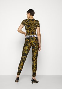 Versace Jeans Couture - Leggings - Trousers - black - 2