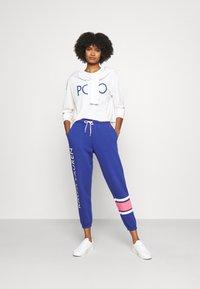 Polo Ralph Lauren - ANKLE-ATHLETIC - Tracksuit bottoms - beach royal - 1