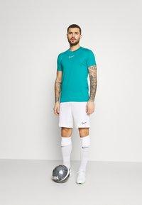 Nike Performance - DRY - T-shirt con stampa - aquamarine/white - 1