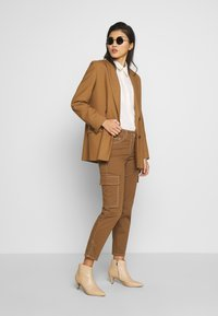 Gerry Weber Casual - Trousers - tabak - 1