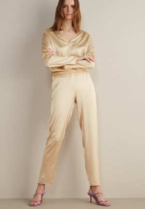 Trousers - crema
