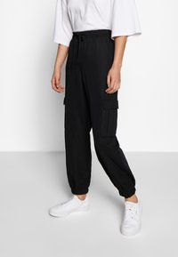 Urban Classics - Trousers - black - 0