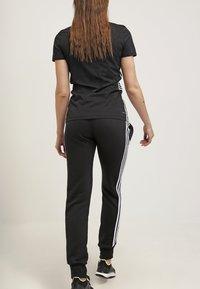 adidas Performance - ESSENTIALS  - Verryttelyhousut - black/white - 2
