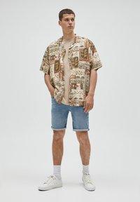 PULL&BEAR - Denim shorts - mottled blue - 1