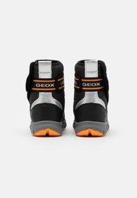 Geox - FLEXYPER BOY ABX - Winter boots - black/orange - 2