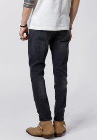 Tigha - Slim fit jeans - vintage black - 2