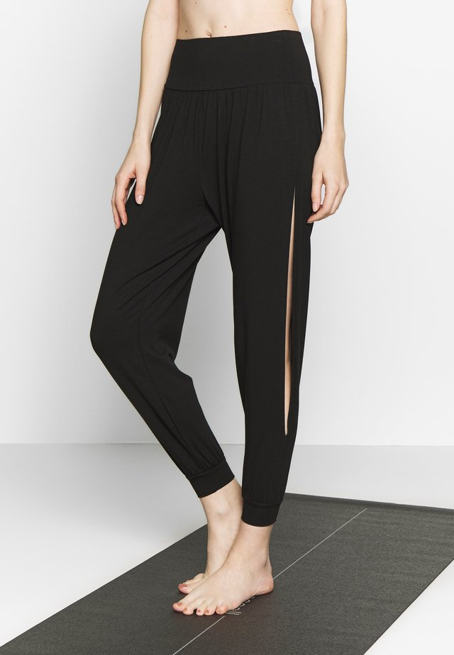 BOHEMIAN PANTS - Tracksuit bottoms - black