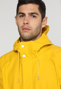 Helly Hansen - MOSS RAIN COAT - Waterproof jacket - essential yellow - 3