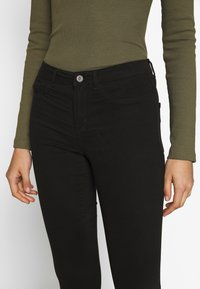 ONLY - ONLMIRINDA BASIC PANT - Jeans Skinny Fit - black - 4