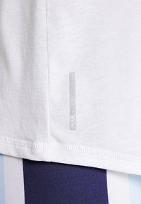 Puma - HIT FEEL IT TANK - Sports shirt - white - 4