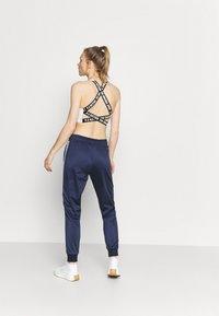 Fila - JACOBA TAPED TRACK PANTS - Tracksuit bottoms - black iris - 2