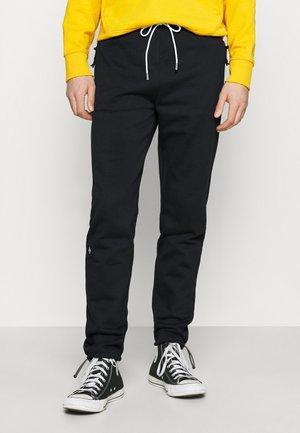 DAGGER PANT UNISEX - Spodnie treningowe - converse black