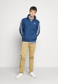 adidas Originals - LOCK UP ADICOLOR SPORT INSPIRED TRACK TOP - Training jacket - blue - 1