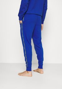 Diesel - UMLB-PETER TROUSERS - Pyjama bottoms - blue - 2