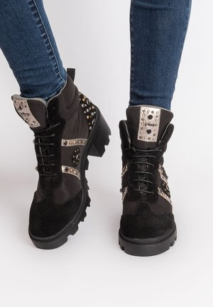 GAIBA - Lace-up ankle boots - black