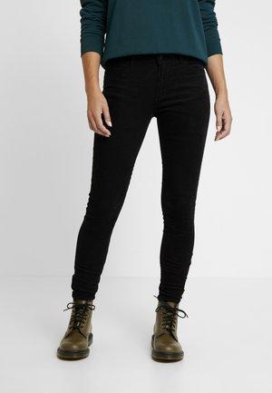 SKINNY - Trousers - black