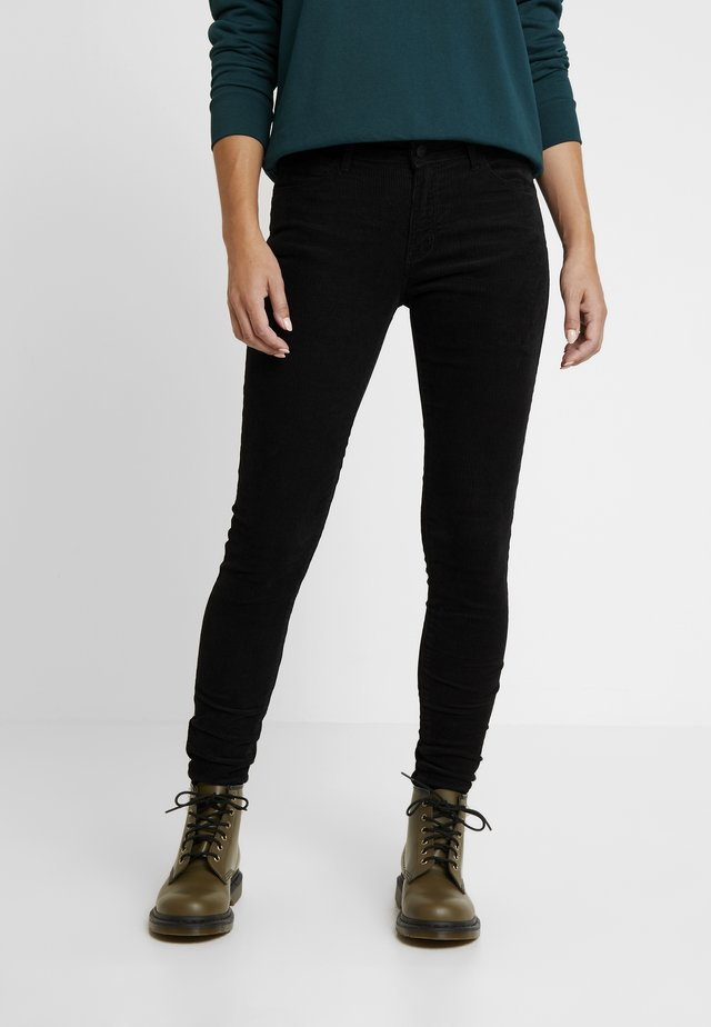 SKINNY - Trousers - black