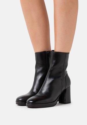 ASTA - Platform ankle boots - black
