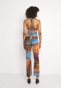 Jaded London - SLIGHT FLARED LEG BEACH TROUSER WITH XL BINDING HEATMAP PRINT - Trousers - brown/ blue/multi - 2