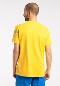 Haglöfs - MIRTH  - Print T-shirt - pumpkin yellow - 1