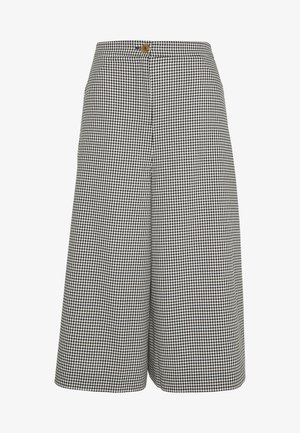 TROUSERS - Trousers - black/white