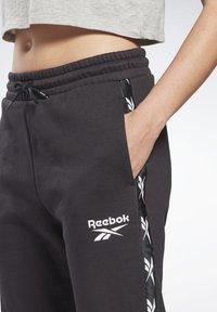 Reebok - TAPE JOGGERS - Pantaloni sportivi - black - 3