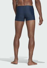 adidas Performance - BADGE SWIM FITNESS BOXERS - Swimming trunks - blue - 1