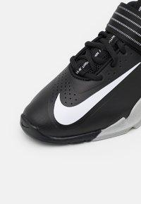 Nike Performance - SAVALEOS UNISEX - Sports shoes - black/white/grey fog/laser orange - 5