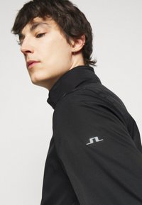 J.LINDEBERG - TERRY POLY STRETCH - Short coat - black - 5