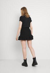 NIKKIE - RIVKA SKIRT - Mini skirt - black - 2