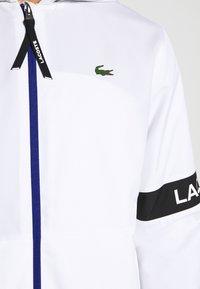 Lacoste Sport - TENNIS JACKET - Waterproof jacket - white/black - 5