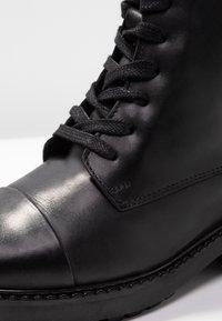 Zign - Šněrovací kotníkové boty - black - 2