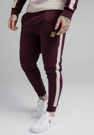 CUT AND SEW JOGGERS - Tracksuit bottoms - wine/cream