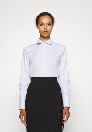 THE FITTED SHIRT - Button-down blouse - light pastel blue