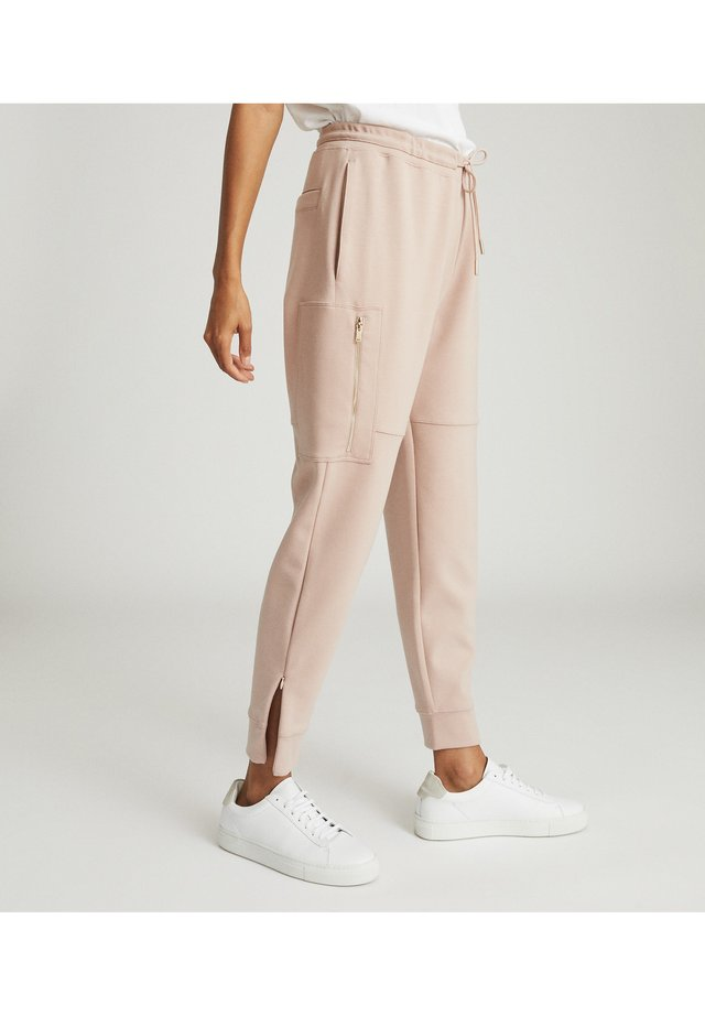 ANGELINA - Tracksuit bottoms - light pink