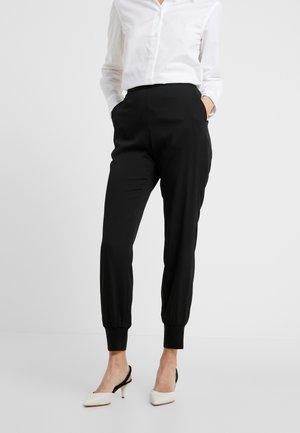 BRINA - Teplákové kalhoty - black