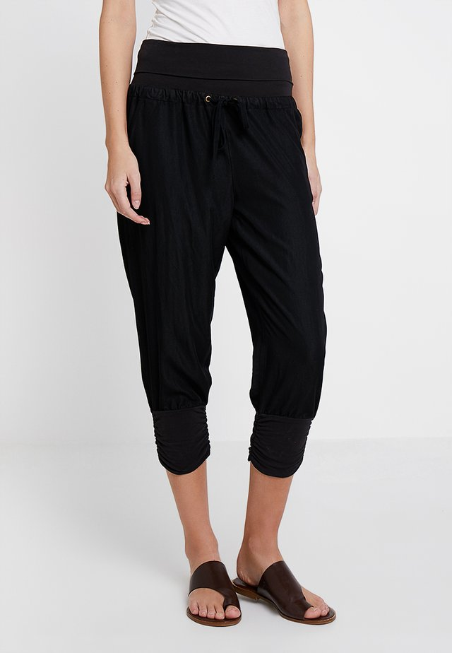 LINE PANTS - Trousers - solid black