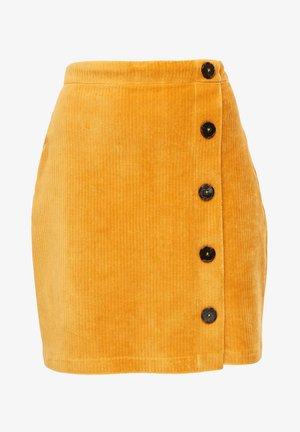 MIT ZIERKNOPFLEISTE - Mini skirt - yellow