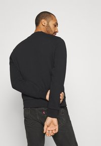 Calvin Klein - GRAPHIC LOGO - Sweatshirt - black - 2