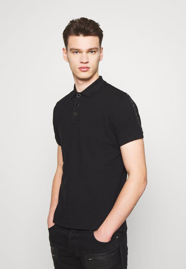SIDE TAPING - Koszulka polo - black
