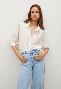 Mango - CAROL - Flared Jeans - light blue - 3