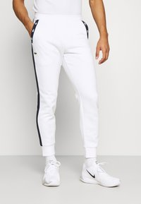 Lacoste Sport - PANT TAPERED - Tracksuit bottoms - white/navy blue - 0