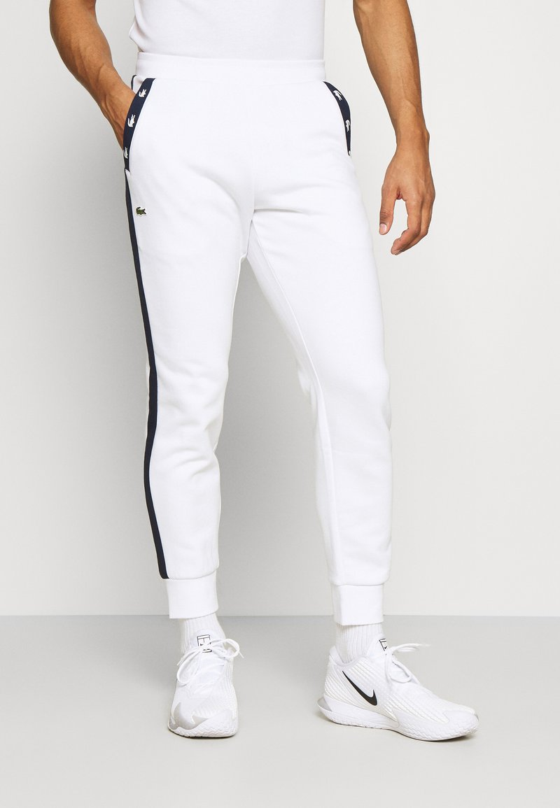 Lacoste Sport - PANT TAPERED - Tracksuit bottoms - white/navy blue