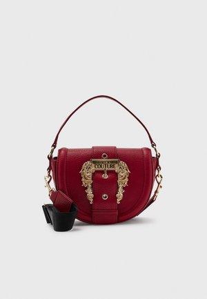 GRANA BUCKLE CROSSBODY - Handbag - blood